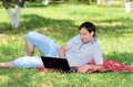 Young man with laptop outdoors Stock Image
