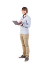 Young man with a laptop student standing and smiling Stock Photos