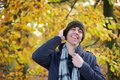 Young man laughing outdoors on an autumn day portrait of a Royalty Free Stock Photo
