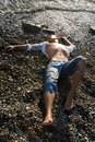 Young man lies on coastline Royalty Free Stock Photography