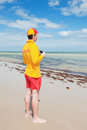 Young man life saver watching situation sea Royalty Free Stock Photo