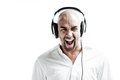 Young man listening to loud music and screaming isolated on white Stock Images