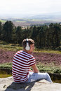 Young man listening to music in countryside on headphones relaxing Stock Photography