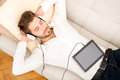 Young man listening to music a handsome on the couch Royalty Free Stock Photos