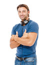 Young man listening to music a handsome standing with arms crossed against white background Stock Image