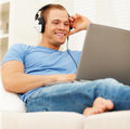 Young man listening to music from the internet Royalty Free Stock Images