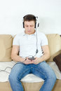 Young man listening to music on mobile phone with headset Royalty Free Stock Photo