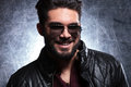 Young man with long beard and sunglasses smiling happy to the camera Royalty Free Stock Image