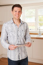 Young Man Looking At Details For New Home Royalty Free Stock Photo