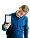 Young man looking at ebook reader handsome holding and it isolated on white Royalty Free Stock Photography