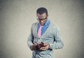 Young man looking into his empty wallet has no money Royalty Free Stock Photo