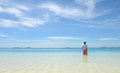 Young man looking at horizon on tropical beach back portrait of single standing white sand and semporna sabah malaysia Stock Photography
