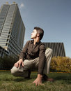 Young man looking over at a building Royalty Free Stock Photo