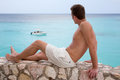 Young man looking at sea on vacation a is while traveling Royalty Free Stock Photos