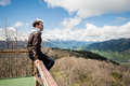 Young man looking at the view from a top of mountain. Royalty Free Stock Photo