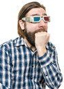 The young man looks through stereo glasses with a beard is isolated on a white background Stock Image