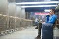 Young man making call at airport Royalty Free Stock Photo