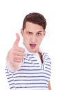Young man making thumbs up gesture Stock Images