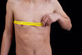 Young man measuring his chest Royalty Free Stock Photo