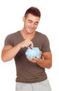 Young man with a money box isolated on white background Stock Image