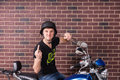 Young Man on Motorcycle Giving Finger to Camera Royalty Free Stock Photo