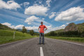 Young man mountain road sky Stock Images