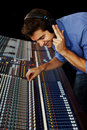 Young man in music recording studio Stock Photo