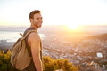 Young man on nature trail with a view of city Royalty Free Stock Photo