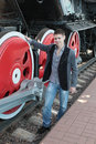 Young man near locomotive Royalty Free Stock Images