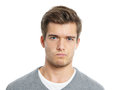 Young man is not happy making a face Stock Images
