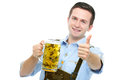 Young man with a oktoberfest beer stein in traditional bavarian tracht holds and shows thumb up Royalty Free Stock Photo