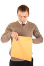 Young man opens a post package Royalty Free Stock Photo