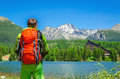 Young man with orange backpack at Strbske Pleso