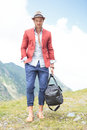 Young man outdoor with bag in hand Royalty Free Stock Photos