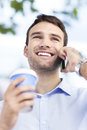 Young man outdoors with coffee portrait of business smiling Royalty Free Stock Photography