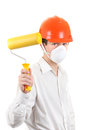 Young man with paint roller in hard hat isolated on the white background Stock Photos