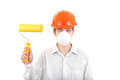 Young man with paint roller in hard hat isolated on the white background Stock Image