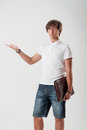 Young man with paper case on the white background Royalty Free Stock Photography
