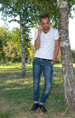 Young man in the park talking on the cell phone hand Royalty Free Stock Photography