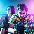 Young man at party doing drugs photo of a men with colorful lights Stock Photos
