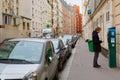 Young man paying at parking meter in Paris Royalty Free Stock Photo