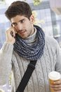 Young man on phone call outdoors talking mobile in the city Stock Photos