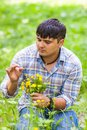 Young man picking up flowers for his woman Royalty Free Stock Photo