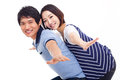 Young man piggybacking his pretty girlfriend Stock Photography