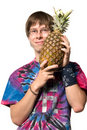 Young man with pineapple Royalty Free Stock Photo