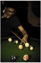 Young man play billiard game with glasses player finding best solution and right angle at billard or snooker pool sport Royalty Free Stock Photos
