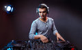 Young man play music on a dj`s mixer at studio Royalty Free Stock Photo