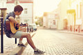 Young man playing on acoustic guitar - outdoor Royalty Free Stock Photo