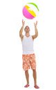 Young man playing with beach ball Stock Images
