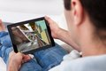 Young man playing game close up of video on tablet pc Stock Photo